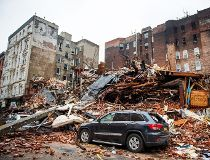 A car sits amongst the rubble after an explosion destroyed
