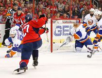 Caps defenceman Karl Alzner beats Isles' Jaroslav Halak during Game 5 of a series that will be decided tonight. (USA Today Sports)