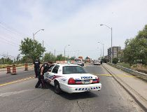 Toronto Police have shut down a section of Markham Rd., north of Eglinton Ave. E., in the wake of a shooting Friday morning. (CHRIS DOUCETTE/Toronto Sun)