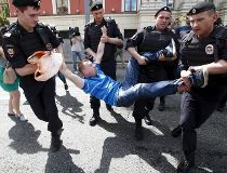 Police detain gay rights activist Alexeyev during LGBT community rally in central Moscow