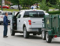 A Ministry of Natural Resources truck arrived minutes after the black bear was shot in Newmarket on Monday, June 1, 2015. (DAVE THOMAS/Toronto Sun)