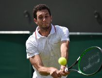 James Ward of Britain hits a shot during his match against Jiri Vesely of the Czech Republic at the Wimbledon Tennis Championships in London, July 2, 2015.            REUTERS/Toby Melville
