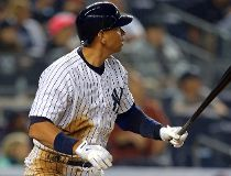 New York Yankees designated hitter Alex Rodriguez (13) watches his two-run home run against the Detroit Tigers during the third inning at Yankee Stadium. (Adam Hunger-USA TODAY Sports)