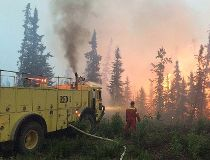 A fire crew battles a blaze in the La Ronge