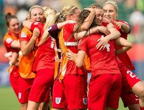England's players celebrate Fara Williams' goal during extra time of their bronze medal match against Germany at the FIFA Women's World Cup in Edmonton, Alberta on July 4, 2015.  AFP PHOTO/GEOFF ROBINS