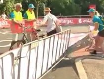 A mailman in the Netherlands threatens Tour de France workers after finding his route is blocked.