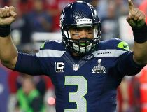 Seattle Seahawks quarterback Russell Wilson celebrates his touchdown pass to wide receiver Chris Matthews (not pictured)  in the final seconds of the first half against the New England Patriots during the NFL Super Bowl XLIX football game in Glendale, Ari