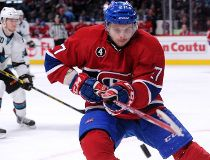 Alex Galchenyuk #27 of the Montreal Canadiens takes a shot at the airborne puck during the NHL game against the San Jose Sharks at the Bell Centre on March 21, 2015 in Montreal, Quebec, Canada.   Richard Wolowicz/Getty Images/AFP