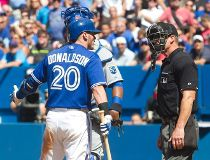 Toronto Blue Jays Josh Donaldson complains to home plate umpire Jim Wolf after he was brushed back by a pitch for the third time in the game during eighth inning AL baseball action between the Blue jays and Kansas City Royals in Toronto on Sunday August 2