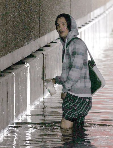 This unidentified man helped cyclist Ryan Drake (R) bike out of  a flooded out 5 St SW near 9 Ave in Calgary, Alta during another storm on Wednesday August 5, 2015. Drake has launched a campaign, with the media's help, to find the good samaritan who helped out. Drake misjudged the depth, flew off his bike, lost his glasses and eventually his bike was found by this unidentified bystander who pulled the bike out of the water.  Jim Wells/Calgary Sun/Postmedia Network