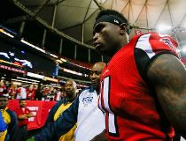 Julio Jones #11 of the Atlanta Falcons walks off the field after beating the Arizona Cardinals at the Georgia Dome on November 30, 2014 in Atlanta, Georgia. The Falcons won 29-18.   Kevin C. Cox/Getty Images/AFP == FOR NEWSPAPERS, INTERNET, TELCOS & TELEV