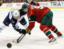 Minnesota Wild center Mikko Koivu (9), of Finland, wins a face-off against Winnipeg Jets center Mark Scheifele (55) during the second period of an NHL preseason hockey game in St. Paul, Minn., Sunday, Sept. 27, 2015.