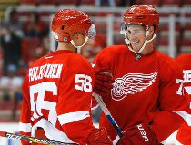 Detroit Red Wings left wing Teemu Pulkkinen (56) and center Dylan Larkin, right, celebrate after the Red Wings defeated the Pittsburgh Penguins 6-1 in a preseason NHL hockey game in Detroit on Thursday, Sept. 24, 2015. Both players had two goals apiece. (