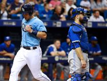 Tampa Bay Rays catcher Luke Maile (46) scores a run as Toronto Blue Jays catcher Russell Martin (55) looks on during the first inning at Tropicana Field. Kim Klement-USA TODAY Sports