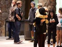 Students embrace outside a hospital emergency room in Flagstaff, Ariz.