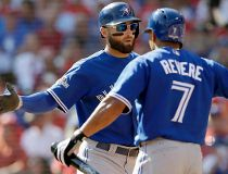 Toronto Blue Jays center fielder Kevin Pillar (11) celebrates his home run against the Texas Rangers with left fielder Ben Revere (7) during the second inning in Game 4 of baseball's American League Division Series Monday, Oct. 12, 2015, in Arlington, Tex