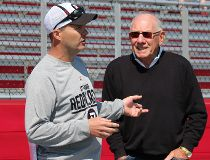 Legendary Ottawa Rough Riders quarterback Russ Jackson chats with RedBlacks coach Rick Campbell