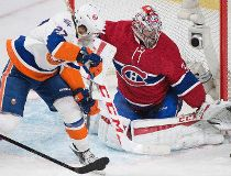 Montreal Canadiens goaltender Carey Price makes a save against New York Islanders' Anders Lee during third period NHL hockey action in Montreal Sunday, November 22, 2015. THE CANADIAN PRESS/Graham Hughes