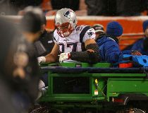 Tight end Rob Gronkowski #87 of the New England Patriots is carted off of the field against the Denver Broncos in the fourth quarter at Sports Authority Field at Mile High on November 29, 2015 in Denver, Colorado.   Justin Edmonds/Getty Images/AFP