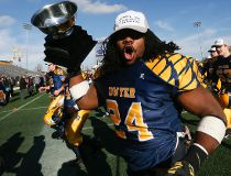 Dawson Odel carries the cup for Monsignor Paul Dwyer CHS (Oshawa) as they defeat St. Joan of Arc CHS (Barrie) in the Eastern Bowl this morning as part of the Football Bowls 2015 at Tim Hortons Field in Hamilton on Sunday November 29, 2015. Stan Behal/Toro