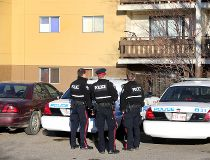 Police investigate a homicide at an apartment on 13408 49 Street