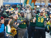 Eskimos' Almondo Sewell (90) and Tony Washington (58)  Grey Cup Edmonton Eskimos Fan Rally