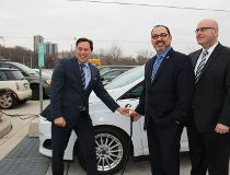 From left, Economic Development Minister Brad Duguid, Liberal MPP Glenn Thibeault and Transportation Minister Steven Del Duca show that charging up an electric vehicle is pretty straightforward.