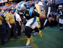 Carolina Panthers' Cam Newton (1) runs onto the field before the NFL Super Bowl 50 football game against the Denver Broncos. Sunday, Feb. 7, 2016, in Santa Clara, Calif. (AP Photo/Matt York)