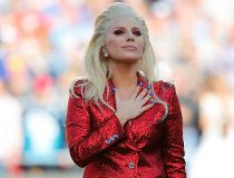 Lady Gaga places her hand over her heart after singing the U.S. National Anthem before the start of the NFL's Super Bowl 50 football game between the Carolina Panthers and the Denver Broncos in Santa Clara, California February 7, 2016.   REUTERS/Mike Blak