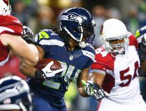 Seattle Seahawks running back Marshawn Lynch (24) rushes against the Arizona Cardinals during the second quarter at CenturyLink Field.  Joe Nicholson-USA TODAY Sports