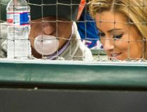In this April 14, 2005 file photo, Johnny Manziel blows a bubble as he watches from the seats behind home plate with Colleen Crowley as the Texas Rangers face the Los Angeles Angels in a baseball game at Globe Life Park in Arlington, Texas. (Smiley N. Poo