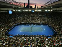 The sun sets over Rod Laver Arena during the men's singles final between Novak Djokovic of Serbia and Andy Murray of Britain at the Australian Open tennis championships in Melbourne, Australia, Sunday, Jan. 31, 2016.(AP Photo/Vincent Thian)