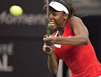 Canada's Francoise Abanda returns a shot to Belarus' Aliaksandra Sasnovich during the opening match of the Fed Cup tie, Saturday Feb. 6, 2016, in Quebec City. THE CANADIAN PRESS/Jacques Boissinot
