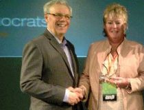 Heather Grant-Jury receives the Stanley Knowles Solidarity Award at the 2013 Manitoba NDP Convention in Brandon, with Premier Greg Selinger.
