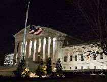 U.S. flag at half-mast in front of SCOTUS