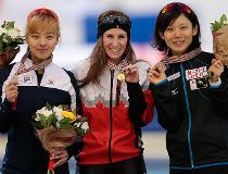 Kim Bo-Reum, of Korea, Ivanie Blondin, of Canada, and Takagi Miho, of Japan