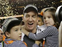 Denver Broncos' Peyton Manning (18) celebrates with his son Marshall and daughter Mosley after the NFL Super Bowl 50 football game Sunday, Feb. 7, 2016, in Santa Clara, Calif. The Broncos won 24-10. (AP Photo/David J. Phillip)