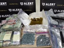 ALERT has arrested three people in Edmonton following a seizure of 1,255 fentanyl pills and other drugs. (Supplied)