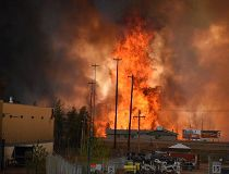 Flames rise in the industrial area south of Fort McMurray May 3, 2016.