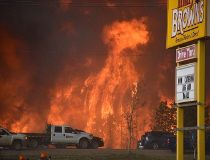 A wall of fire rages outside of Fort McMurray, Alta. Tuesday May 3, 2016. (THE CANADIAN PRESS/HO-CBC-Terry Reith)
