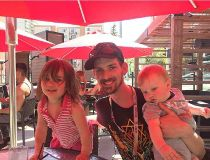 Lawrence Cooper with his children, Tegan Rae, two, and Dax, eight months, on the patio at Earls in downtown Edmonton