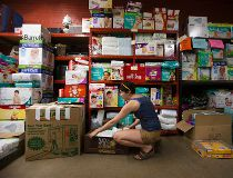 A volunteers sorts donations for Fort McMurray at the Edmonton Emergency Relief Services