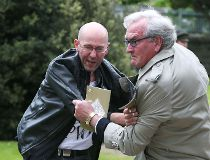 Canadian Ambassador to Ireland Kevin Vickers wrestles with protester