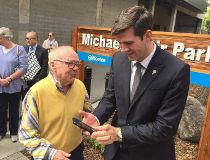 Former city councillor Michael Phair and Mayor Don Iveson after taking a selfie at the unveiling of Michael Phair Park on 104th Street