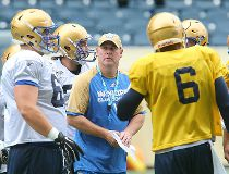 Winnipeg Blue Bombers offensive coordinator Paul LaPolice (c) speaks with players during CFL football practice in Winnipeg, Man. Wednesday May 25, 2016.
