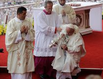 Pope Francis helped back onto feet