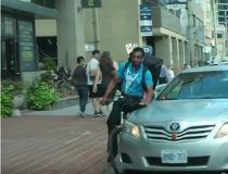 cabbie striking cyclist
