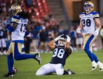 Toronto Argonauts fullback Declan Cross (38) reacts after missing a catch as Winnipeg Blue Bombers defensive back CJ Roberts (17) and Blue Bombers linebacker Ian Wild (38) look on during second half CFL football action in Toronto on Friday, August 12, 201