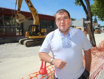 Ruslan Zeleniuk, owner of Svitoch Ukrainian Imports, stands by the road construction on Selkirk Avenue in Winnipeg Aug. 30, 2016. Zeleniuk is upset that the road construction has slowed his business.