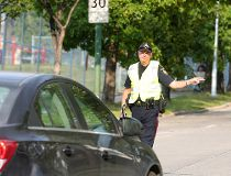 Winnipeg Police Constable Ray Howes pulls over a driver for speeding in a school zone Thursday.
